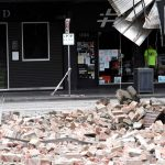 x95374818_TOPSHOTAn-emergency-and-rescue-official-examine-the-damage-to-a-building-in-the-popular.jpg.pagespeed.ic.sUwC9p6bZq